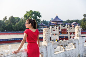 Wall Mural - Woman relaxing enjoying scenic view at religious tourist attraction in Beijing, china. Asia travel old temple in summer park.