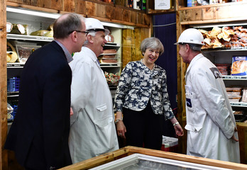 Britain's Prime Minister Theresa May and her husband Philip visit Smithfield Market during a Conservative Party general election campaign visit in the City of London