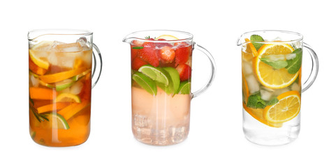 Different drinks in glass jugs on white background. Ideas for summer cocktails