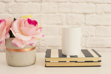 White Mug Mockup. Blank White Coffee Mug Mock Up. Styled Photography. Coffee Cup Product Display. Coffee Mug On Striped Design Notebooks. Vase With Pink Roses