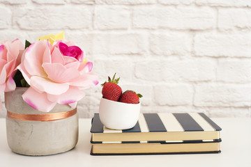 Pink Roses Mock Up. Styled Photography. Brick Wall Product Display. Strawberries On Striped Design Notebooks. Vase With Pink Roses