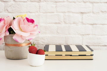 Pink Roses Mock Up. Styled Photography. Brick Wall Product Display. Strawberries On Striped Design Notebooks. Vase With Pink Roses. Fashion Lifestyle