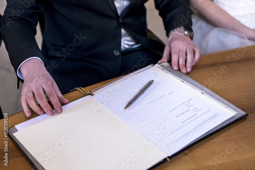 Marriage Elegant Groom Signing German Wedding Register Holding Pen And Official Doent