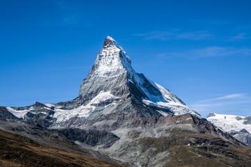 Matterhorn peak on a cloudless blue sky, sunny day.