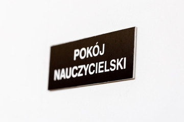 School staff room label on closed door in Polish school