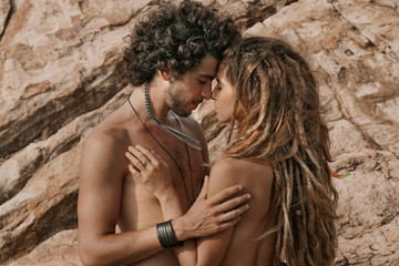 Beautiful boho style man and woman outdoors. sensual couple
