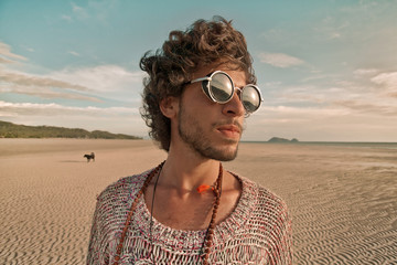 Hippie style man in sunglasses portrait outdoors