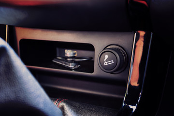 The Car cigarette lighter in a car interior. selective fous.