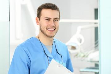 Doctor male posing in an dentist office