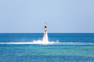 Photo Blinds Water Motor sports Man on a flyboard in the sea