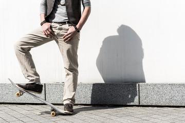 Energetic trendy guy is standing in open air