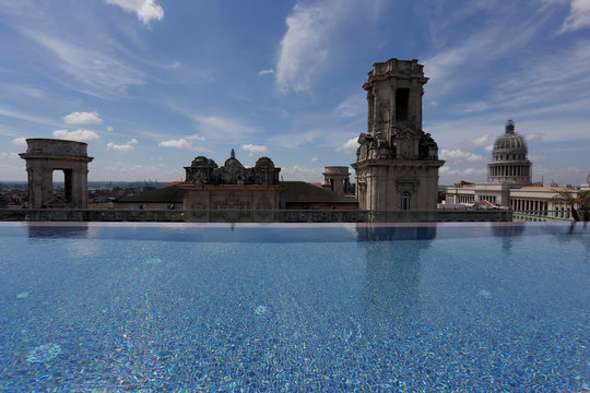 A historic building is seen from the rooftop infinity pool at the Gran Hotel Manzana, in Havana