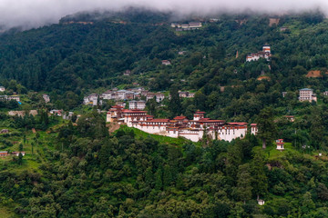 View of Trongsa Dzong and Ta-Dzong with foggy hills, Bumthang, Bhutan, Asia.