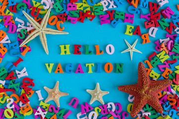 Beach vacation. the word VACATION written by little color letters at blue background