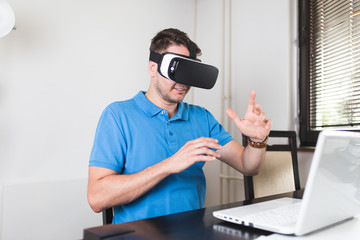 Young man using virtual reality headset or glasses.