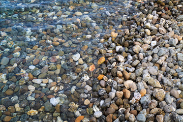 Background of rounded pebbles at sea coast.