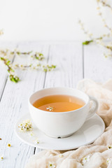 Fresh herbal tea with blooming brunch