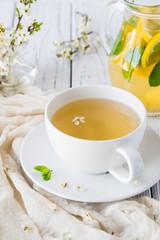Fresh herbal tea with blooming brunch