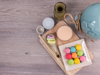 Sweet colorful macaroons on a wood background