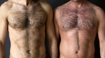 two men with naked chest standing together