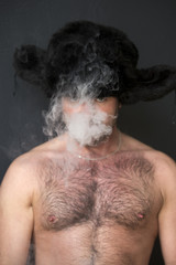 portrait of man with naked chest smoking a cigarette
