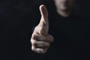 man pointing his finger as a gun Wall mural
