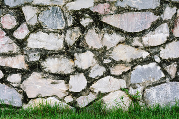 old wall rock and grass texture