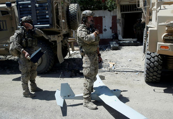 U.S. soldiers are pictured as they prepare to fly a drone at the site of fighting between the Iraqi forces and Islamic State militants in Mosul's al-Zanjili's district in Iraq