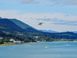 Juneau Alaska, A sightseeing pontoon sea plane taking off or landing in the Gastineau Channel