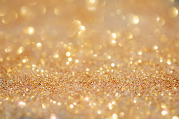 Gold light bokeh texture or glitter lights festive gold background. Christmas abstract template