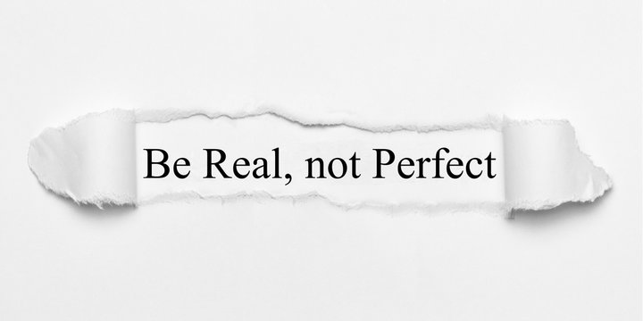 Be Real, not Perfect on white torn paper