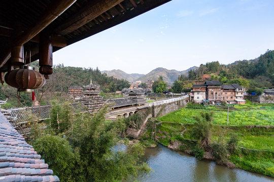 view of Chengyang Wind and Rain Bridge and gardens