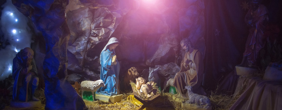Nativity scene with figurines of Jesus, Mary, Joseph, sheep, magi