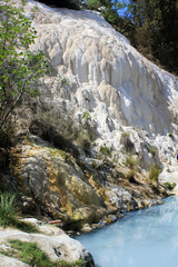 The free accessible pool of Bagni San Filippo hot springs in Italy with its califerous formation and nobody around