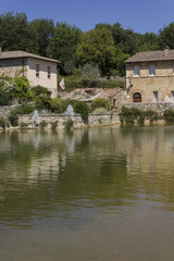 Bagno Vignoni medieval town with its square with hot spring thermal water, in Tuscany, Italy
