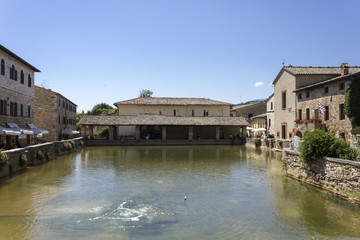 The small medieval town of Bagno Vignoni in Italy, with its hot spring thermal bath
