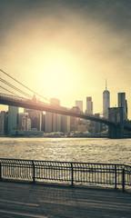 Retro toned sunset over Manhattan and Brooklyn Bridge, New York City, USA.