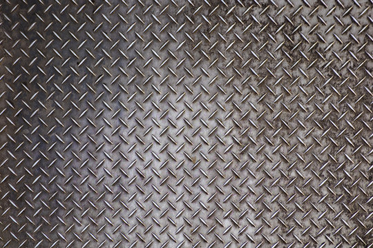 Grey grunge metal textured wall background