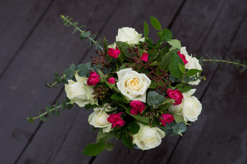 Wedding bouquet with roses and carnations in baroque style