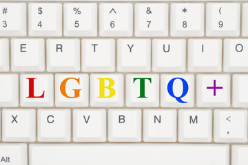 A close-up of a keyboard with highlighted text LGBTQ+