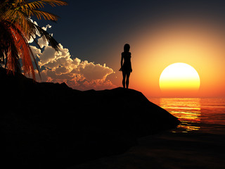 Silhouette of a young girl at sunset