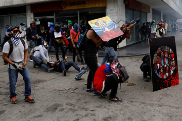 Demonstrators use a giant slingshot during riots at a rally against Venezuelan President Maduro's government in Caracas
