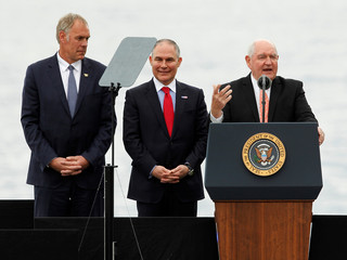 U.S. Secretary of Agriculture Sonny Perdue addresses the crowd as Scott Pruitt, administrator of the Environmental Protection Agency, and Secretary of Interior Ryan Zinke listen before introducing U.S. President Donald Trump at a rally in Cincinnati