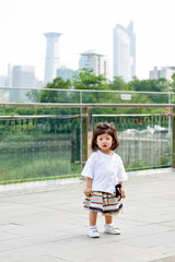 Asian toddler girl in China shooting outdoor portraits