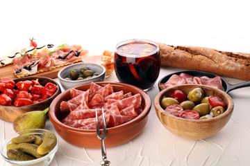 spanish tapas and sangria on wooden table - mediterran antipasti set