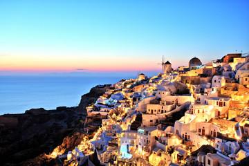 Illuminated Oia Village at Sunset on Santorini Island Greece