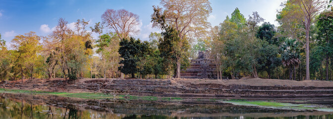 Phimeanakas is a Hindu temple on the shore of an artificial pond, located inside the walled enclosure of the Royal Palace of Angkor Thom north of Baphuon, Siem Reap, Cambodia. World Heritage