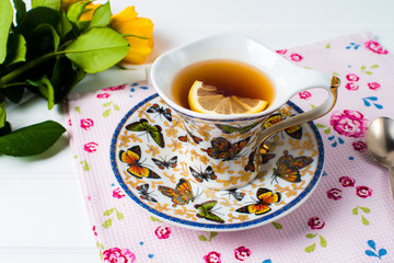 cups of tea with mint on wooden table