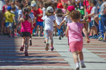 boys and girls running in a race back view