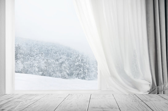 Modern residential window with snow landscape